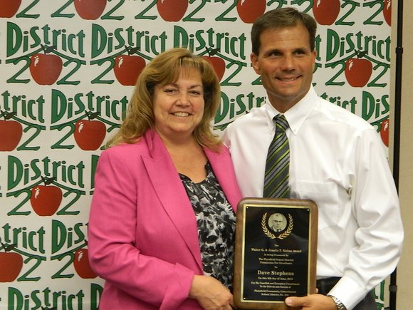 "Dave Stephens was recognized at Monday night's school board meeting as being someone who shows ""extraordinary commitment to district students, ..."