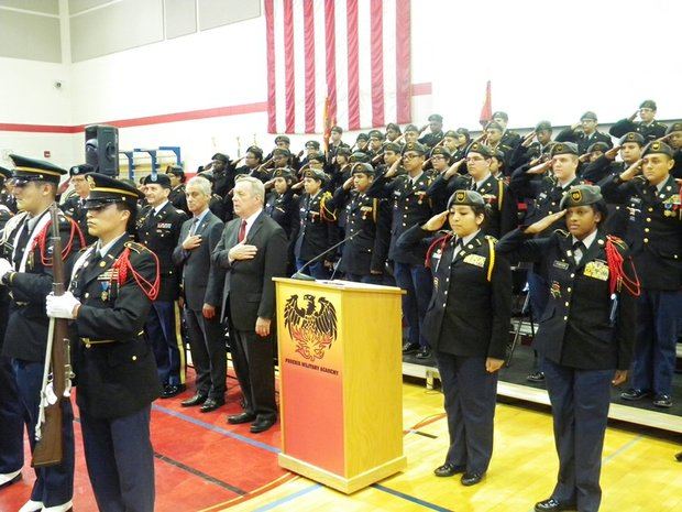 U.S. Senator Dick Durbin (IL-D) (middle right) and Chicago Mayor Rahm Emanuel reflect during the playing of the National Anthem at Phoenix Military Academy, 145 S. Campbell Ave.  Phoenix Military Academy received a $6 million federal grant administered by the U.S. Dept. of Defense (DOD) for a new STEM and Leadership Academy Pilot Program.