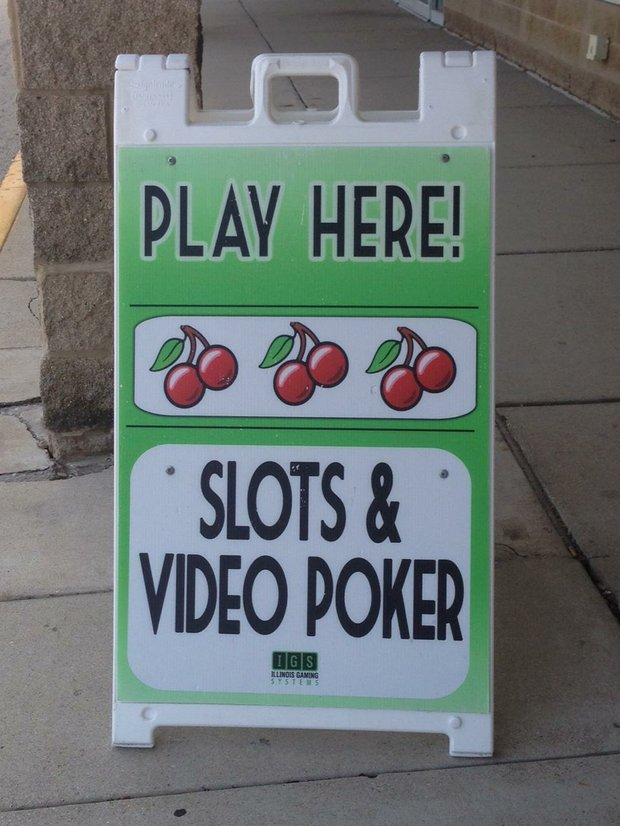 A small sign sits outside Bonny's Bistro in Joliet advertising its video gaming machines.