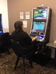 A patron tries her luck on a video gaming machine on Bonny's Bistro, one of many gaming cafes that are located in Joliet.