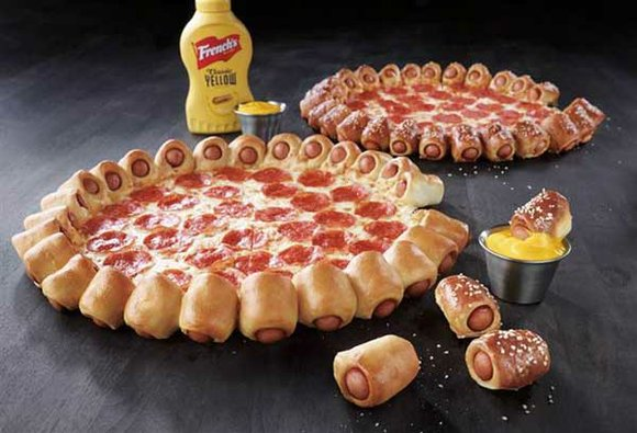 Pizza Hut bets you want some booze delivered with that pepperoni pie. The pizza chain said Tuesday that it will ...