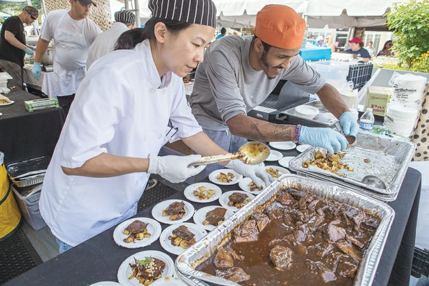 Caterers Ellie Basch and Jonah Rueda of Everyday Gourmet help satisfy appetites with a dish known as Isley's Brewery Choosy Mothers Peanut Butter Porter braised short ribs on chili lime potato salad.