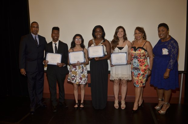 PAB members Michael Lacy and Guillermina Hall pose with Ta Mia Morrow (COE Coordinator) and scholarship recipients
