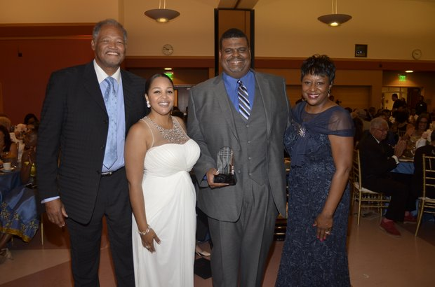 Dr. Henry Shannon (Chaffey College), Ta Lese Morrow (IVN Co-Publisher), and Juanita Dawson (PAB) congratulate Dr. Eric Bishop (Honoree)