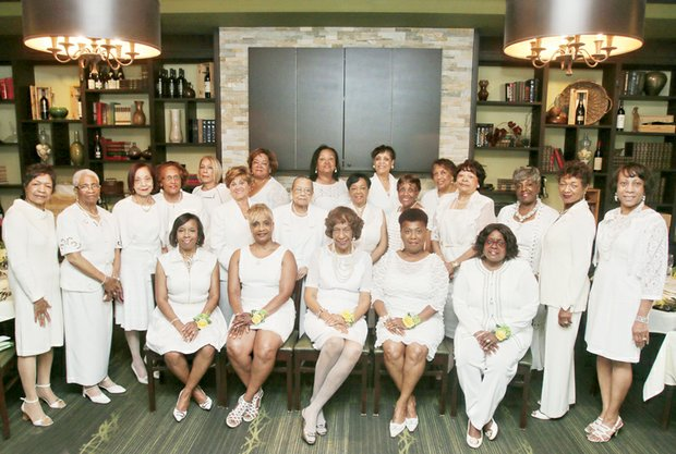 """CHUMS INDUCT 5 - Members of the Richmond Chapter of Chums Inc. proudly celebrate five new members after an installation ceremony June 14 at a Henrico County restaurant. The new members are, seated from left, Dr. Yvonne Brandon, Denise Lewis, Oneida Rozier, Cheryl Burke and Dr. Deborah Jewell-Sherman. The """"Hums,"""" husbands and significant others of the members, joined the celebration for a cocktail hour and dinner following the ceremony."""