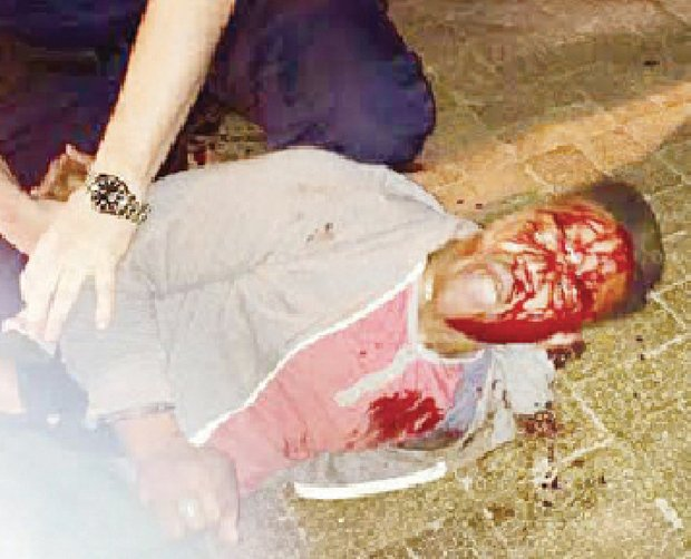 Bloodied University of Virginia student Martese Johnson is held down by an ABC agent after being slammed to the ground March 17 outside a Charlottesville pub.