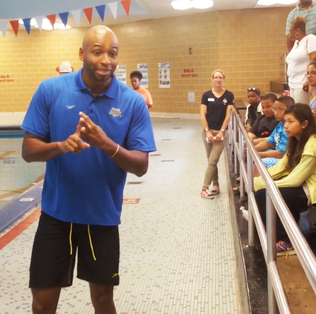 "Two-time Olympic swimming gold medalist Cullen Jones speaks to children before taking them out in the pool for a swimming lesson at Foster Park, 1440 W. 84th St., as part of USA Swimming Foundation and Philips 66's ""Make A Splash"" initiative  aimed at teaching youth swimming basics to decrease drowning rates nationwide."