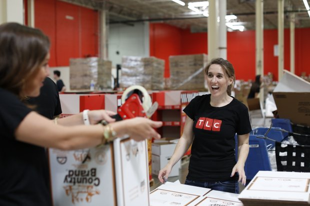 TLC employees helped to package more than 6,000 pounds of food at the Maryland Food Bank on Tuesday.