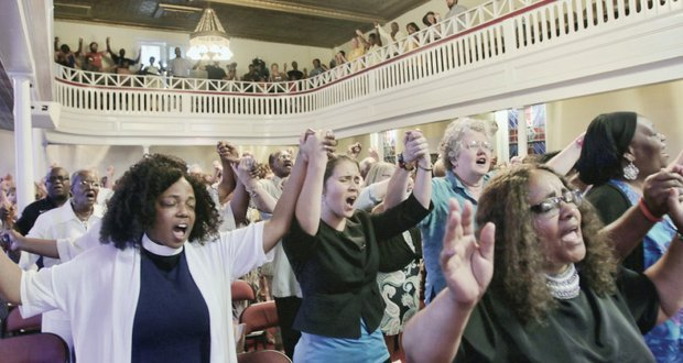 "Worshippers sing ""We Shall Overcome"" at the unity rally at Third Street Bethel AME Church in Downtown last Friday to honor the South Carolina shooting victims"