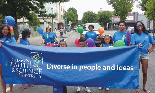 Diversity of Oregon Health and Science University is celebrated as representatives of the medical center march along Northeast Martin Luther King Jr. Boulevard for the 2015 Good in the Hood Parade.