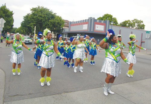The Seattle-based Washington Diamonds drill team marches in Saturday's Good in the Hood Parade.