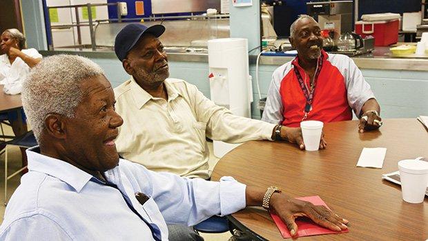 "Longtime South Enders socialize at the United South End Settlements senior lunch program. (l-r) ""Spider"" Edwards, James Banks, Luther Flynt."