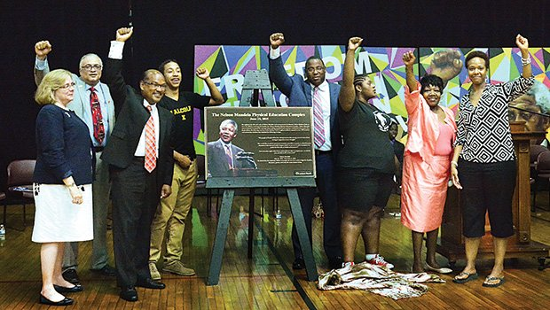 """""""Amandla!"""" was the cry of the day by school kids, elected officials, school administrators and sponsors as they unveiled the Nelson Mandela plaque at Madison Park High School, renaming Building 4 the Nelson Mandela Physical Education Complex."""