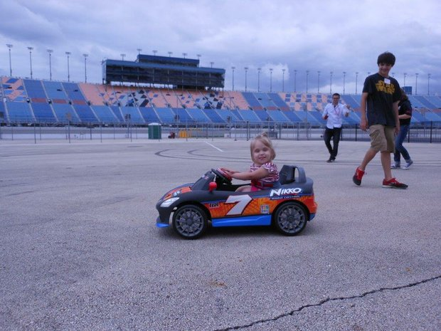 Three-year-old Savannah Healton, who has spina bifida, received a taste of freedom when she drove a small electric car customized for children with mobility problems at Chicagoland Speedway through the Go Baby Go! project.