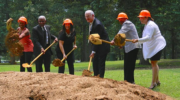 """An adult fitness zone that will be near the southwest entrance of Audubon Park is expected to open by mid to late summer. Pitching in at Tuesday's groundbreaking were (left to right) Latreal """"La"""" Mitchell, Mayor A C Wharton Jr., Michelle Vaeth, Reneé S. Frazier and Janet Hooks. Photo by Dr. Karanja Ajanaku."""
