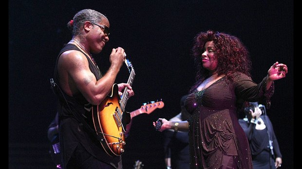 Chaka intermingles with a member of her band. Photo by Warren Roseborough.