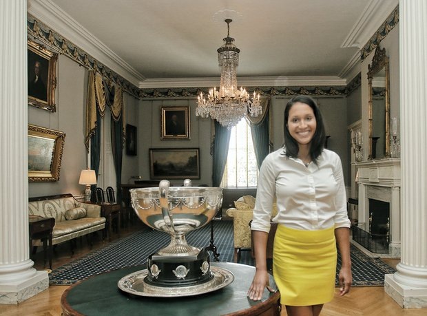 Kaci Easley shows off a portion of the ornate first floor of the 19th century mansion that has served as the residence for 55 governors since it opened in 1813.