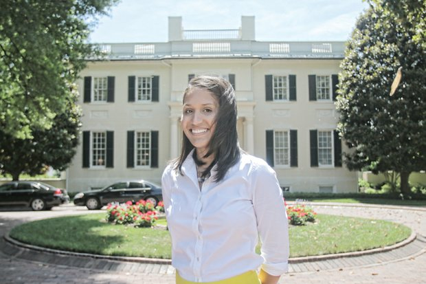 Kaci Easley is the picture of confidence as the executive director of the grand 202-year-old home in Capitol Square where Gov. and Mrs. Terry McAuliffe now live. The Hampton University graduate has a staff of five to help her look after the first couple's needs and makes arrangements for the varied public and private parties, receptions and dinners hosted by the McAuliffes.