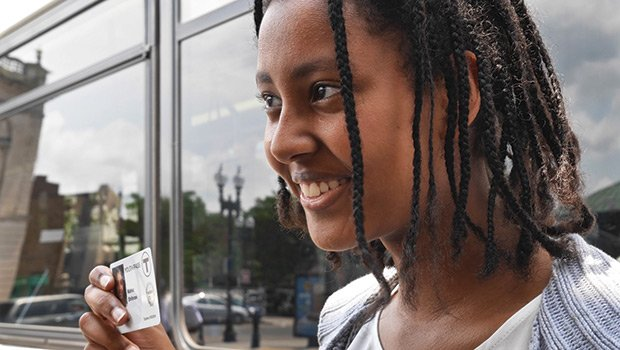 Mahlet Shiferaw of Roslindale displays her new Youth Pass after a celebratory launch event at Dudley Station on July 1.