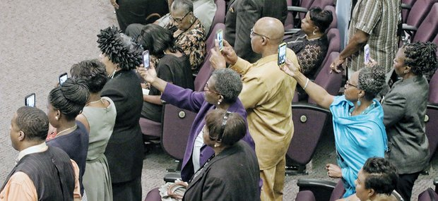 Audience members capture poignant moments on their cell phones during the homegoing service for Maggie Ingram, the revered gospel performer who led Maggie Ingram and The Ingramettes for more than six decades.