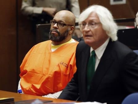"""New video of a fatal parking lot confrontation that led to a murder against Marion """"Suge"""" Knight shows the former ..."""