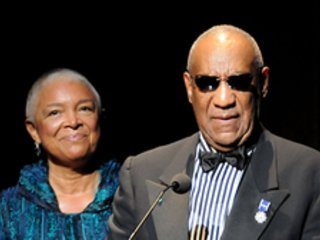 A report that Camille Cosby is standing firmly by her beleaguered husband has folks talking.