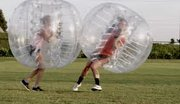 New to Plainfield Fest this year is the Knockerball contest, in which adults don clear inflatable bubbles and bounce into their opponents.