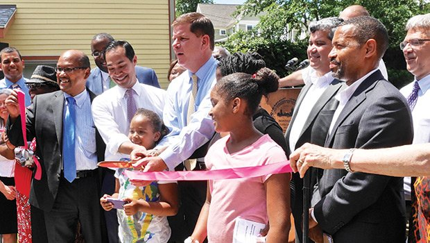 City Councilor Charles Yancey HUD Secretary Julian Castro and Mayor Martin Walsh cut the ceremonial ribbon on the Quincy Heights housing development.