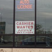 A sign advertising a need for cashiers is posted at the Currency Exchange on Larkin Avenue near Plainfield Road in Joliet.