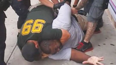 The family of a black man who died after being placed in a white police officer's chokehold reached a $5.9 ...