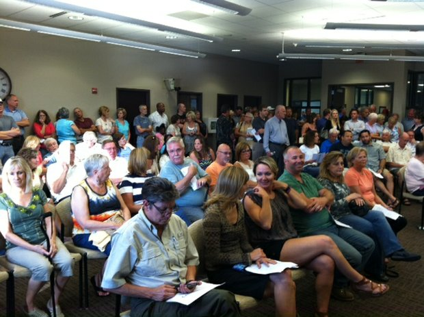 Residents pack the Shorewood Village Hall meeting room Tuesday to offer their opinions prior to the board's decision to approve a special use permit for Lenny's Gas N' Wash at U.S. 52 and River Road.