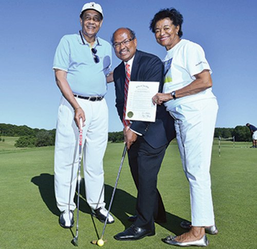 Boston City Councilor Charles Yancey (center) gets ready to play golf after presenting a city-sponsored proclamation to Tom Farrington (l), founder of the Prostate Health Education Network, and his wife Juarez, at the 12th annual Tee Off to Fight Prostate Cancer at Franklin Park.