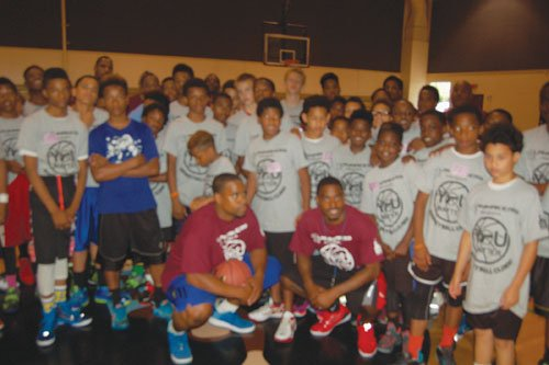 A recent basketball clinic organized by Aaron Miles and Michael Lee, two former Jefferson High School students who went on to accomplish careers in professional basketball, draws dozens of local youth.