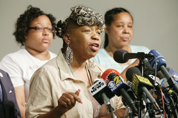 The family of Eric Garner, who died after a white police officer put him in a chokehold a year ago, ...