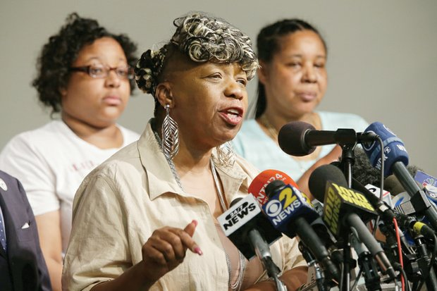 Eric Garner's mother, Gwen Carr, center, is joined by his daughter, Emerald Snipes, left, and widow, Esaw Garner, at a news conference Tuesday in New York. The family spoke after reaching a $5.9 million settlement with the city in the wrongful death case of Mr. Garner, who died after being placed in a chokehold by a white police officer.