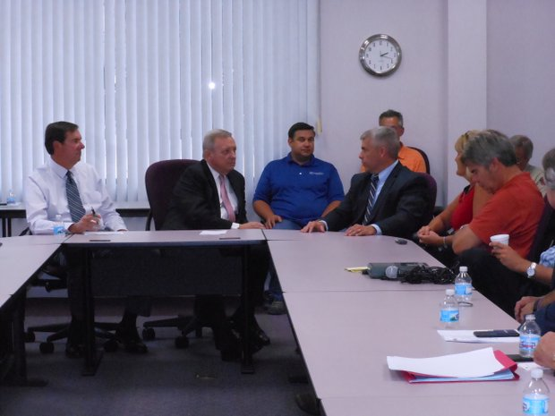 U.S. Sen. Dick Durbin (second from left) meets Joliet Mayor Bob O'Dekirk (fourth from left) and other members of the Joliet Region Chamber of Commerce to discuss funding for road projects.