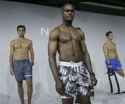 Models wear casual attire during the Nautica presentation at Men's Fashion Week in New York, Wednesday, July 15, 2015.