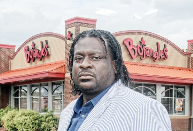 "Bojangles' customer James ""J.J."" Minor feels insulted by a manager's remark made when he returned fast food chicken box filled with cash."