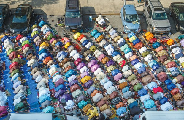 Worshipers in New York's East Harlem neighborhood take part in the traditional prayer marking the end of Ramadan with the Eid al-Fitr holiday on July 17. Prayers took place outside the Masjid Aqsa-Salam mosque.