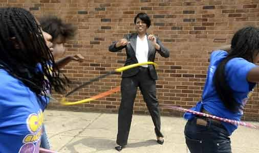 Baltimore Mayor Stephanie Rawlings-Blake spent part of Wednesday, July 15, 2015 showing off her hula-hoop skills to the delight of ...