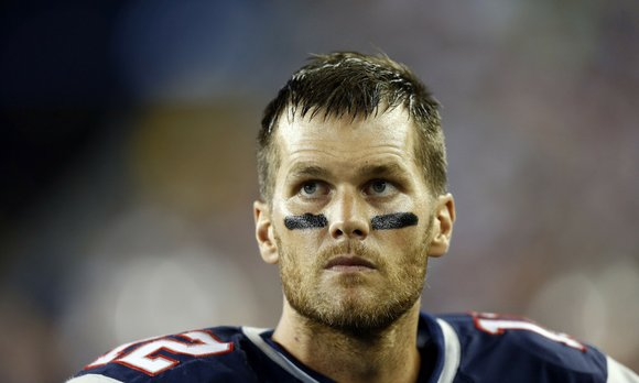 The Super Bowl MVP, whose four-game suspension for using deflated footballs was recently overturned by a judge, grinned broadly as ...
