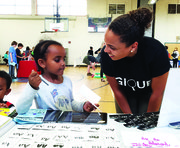 Gique co-founder Danielle Olson works with a young learner.