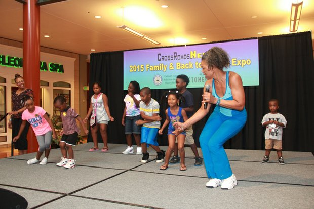 Fitness motivator Rae Rae Clark (right) invited kids to the stage to kick off the 2015 Family & Back-to-School Expo.