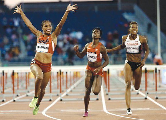 Queen Harrison wears the Pan-American crown as champion of the 100-meter hurdles.