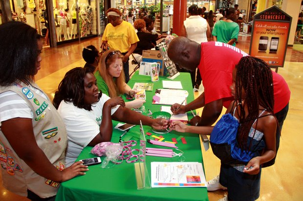 A parent signs up at the Girl Scouts of Greater Atlanta's table.