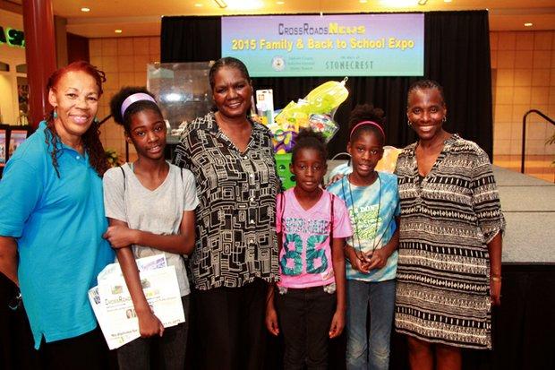Grand prize winner Barbara Grendraw-Patten and her grandchildren are flanked by CrossRoadsNews Publisher Jennifer Parker (left) and Lithonia Mayor Deborah Jackson.