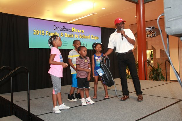 DeKalb County Commissioner Larry Johnson chats with children about the importance of staying in school and getting good grades.