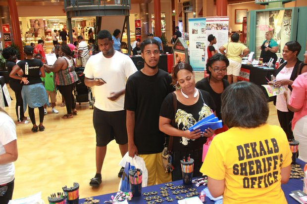 Expo visitors line up to speak with exhibitors at the 2015 Family & Back-to-School Expo.