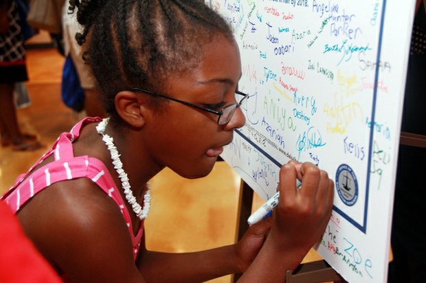 Hundreds of students signed DeKalb Solicitor General Sherry Boston's pledge to strive for perfect attendance.
