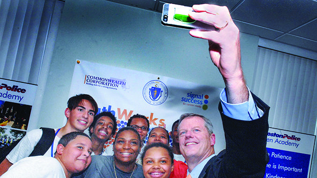 Governor Charlie Baker takes a selfie with ABCD SummerWorks teens at a program celebration in Mattapan on July 30. Among the 100 teens who crowded the Mattapan Center for Life community room were 20 enrollees in the Boston Police Teen Academy, a Boston Police Department initiative that fosters positive relationships between police officers and inner-city youth. In the center is Cynthia Beckford-Brewington, BPD Youth Services Officer. Action for Boston Community Development's SummerWorks program is serving 1,050 inner-city teenagers from low-income families at 250 worksites this summer. At the event, ABCD President/CEO John J. Drew praised the Governor and legislature for increasing youth program funding in the 2016 state budget.